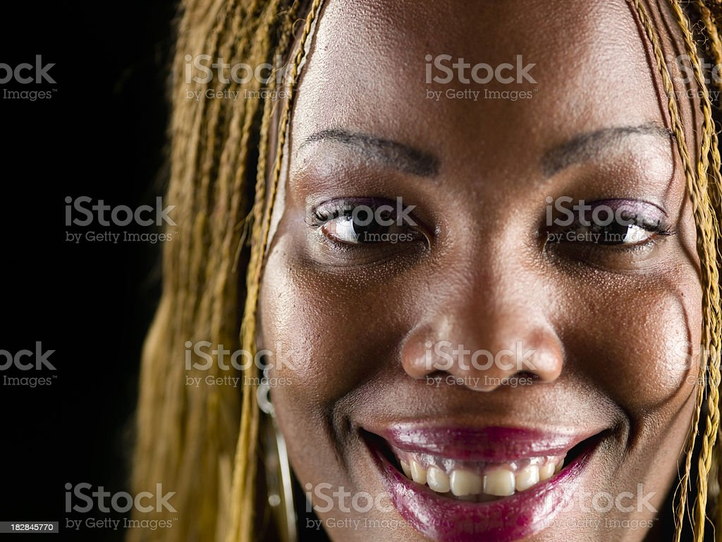 Smiling beautiful afro caribbean woman stock photo