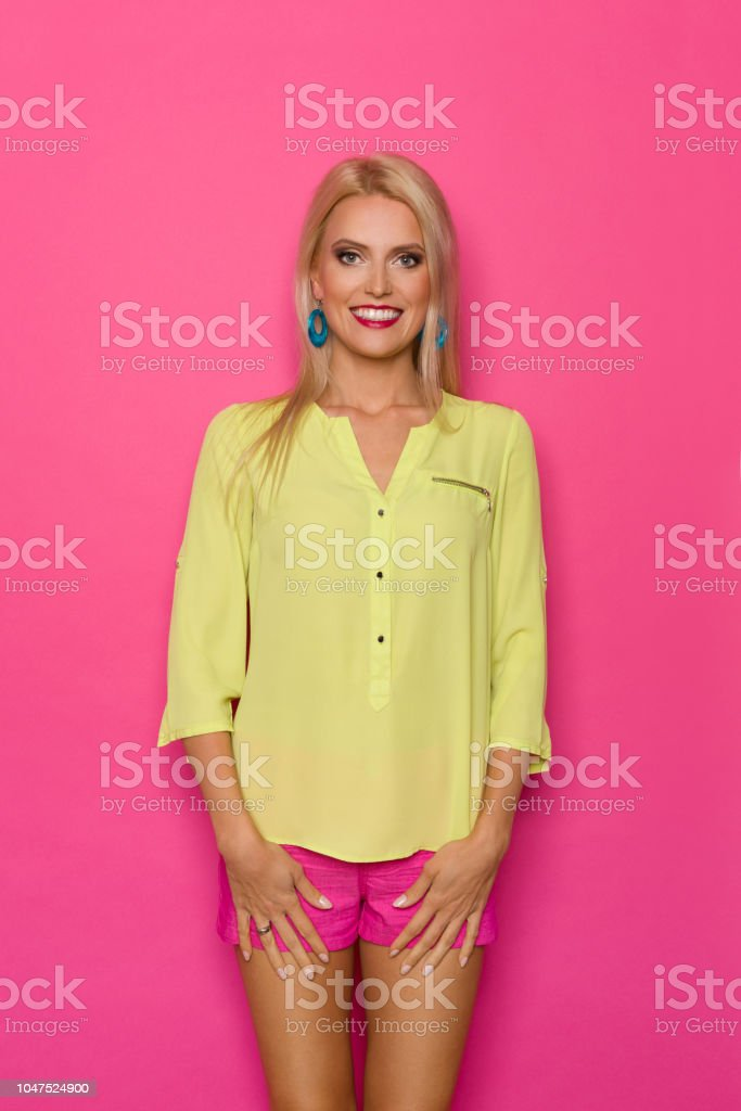 05d2a3f21c179 Smiling Beautiful Blond Woman In Vibrant Clothes Stock Photo   More ...