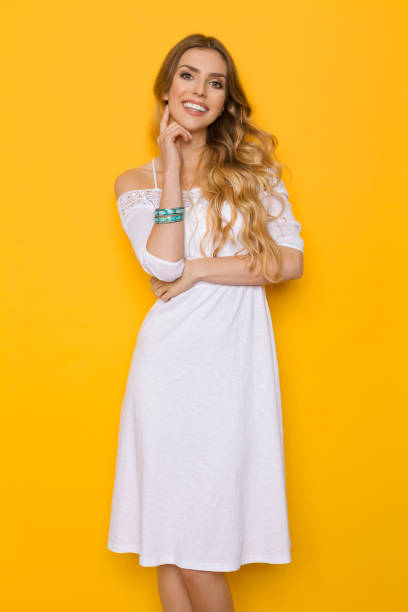smiling beautiful blond young woman in white summer dress - charming stock photos and pictures
