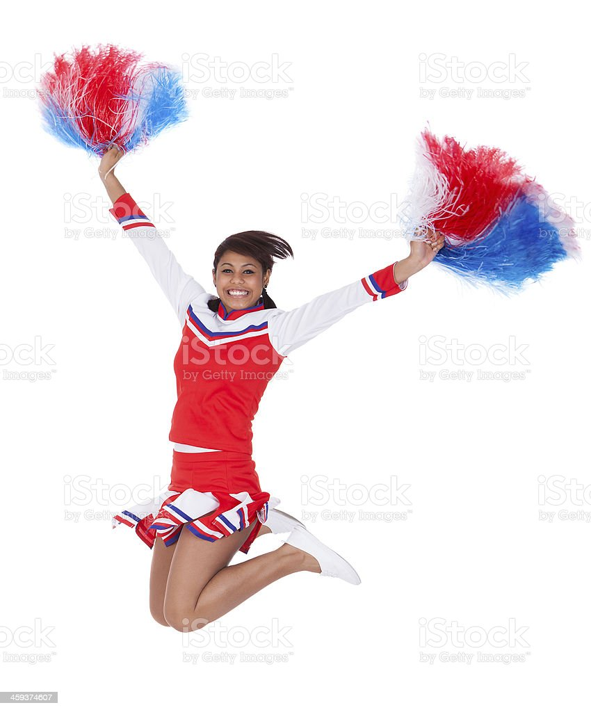 Smiling beautiful cheerleader with pompoms stock photo
