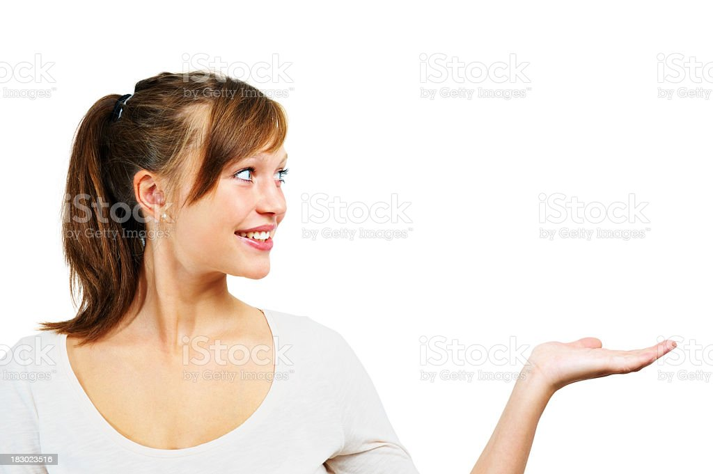Smiling beautiful girl with hand under copyspace royalty-free stock photo