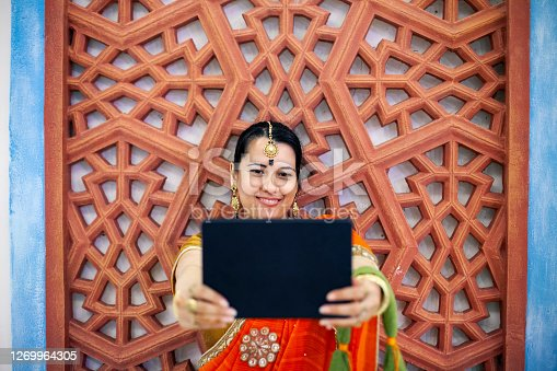 Smiling beautiful Indian girl make selfie with her digital tablet