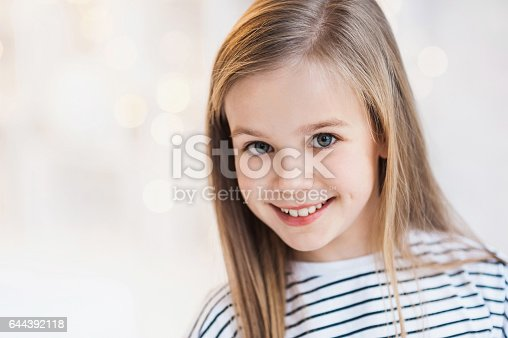 istock Smiling beautiful little girl studio portrait 644392118