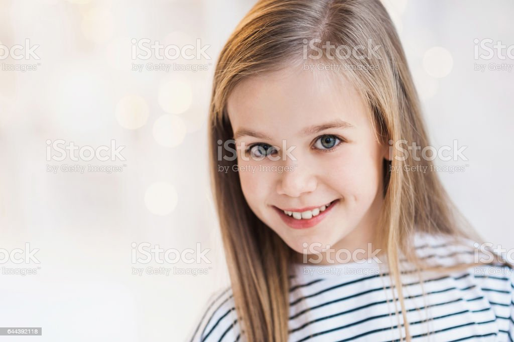 Smiling beautiful little girl studio portrait stock photo