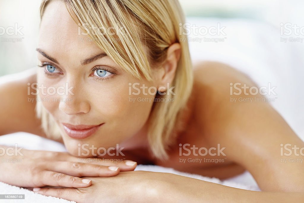 Smiling beautiful mid adult lady relaxing at spa royalty-free stock photo