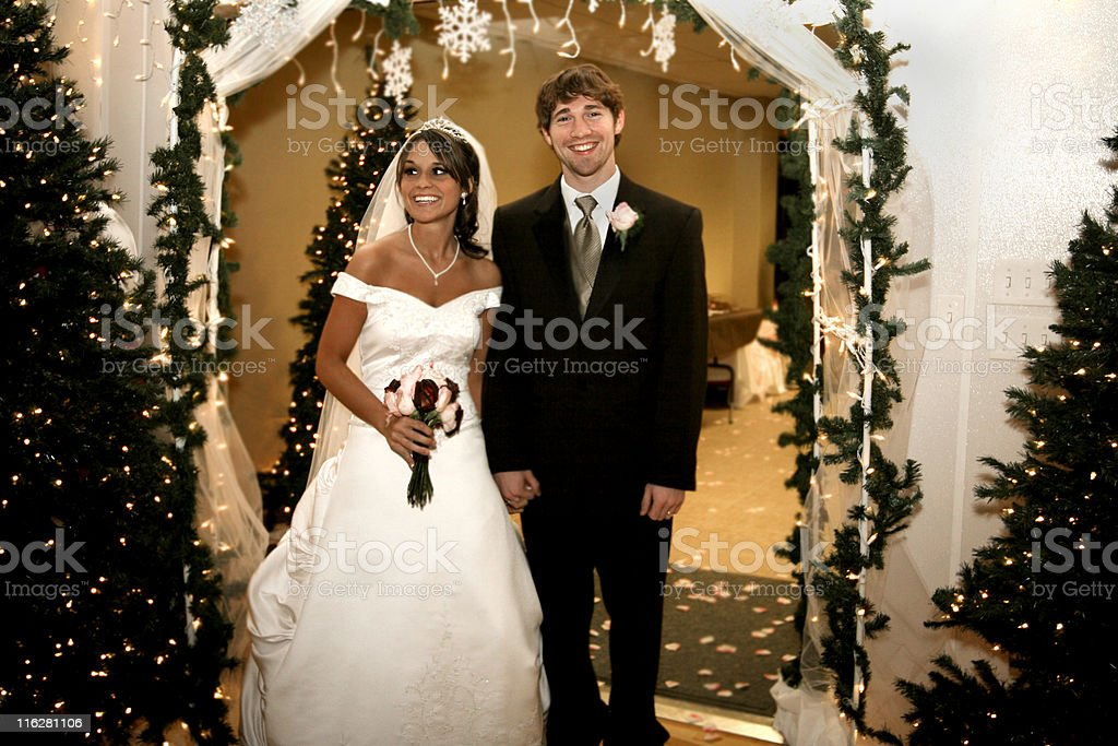 Smiling Beautiful Newly Married Couple Walking Out Of