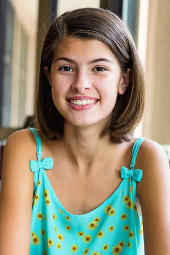 Beautiful blonde teen girl smiling in grass — Stock Photo