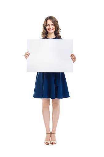 istock Smiling beautiful woman holding empty sign board 847731266