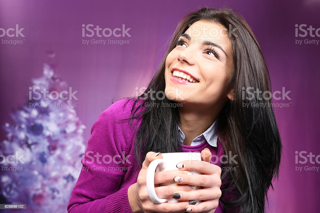 Smiling beautiful woman holding tea cup stock photo