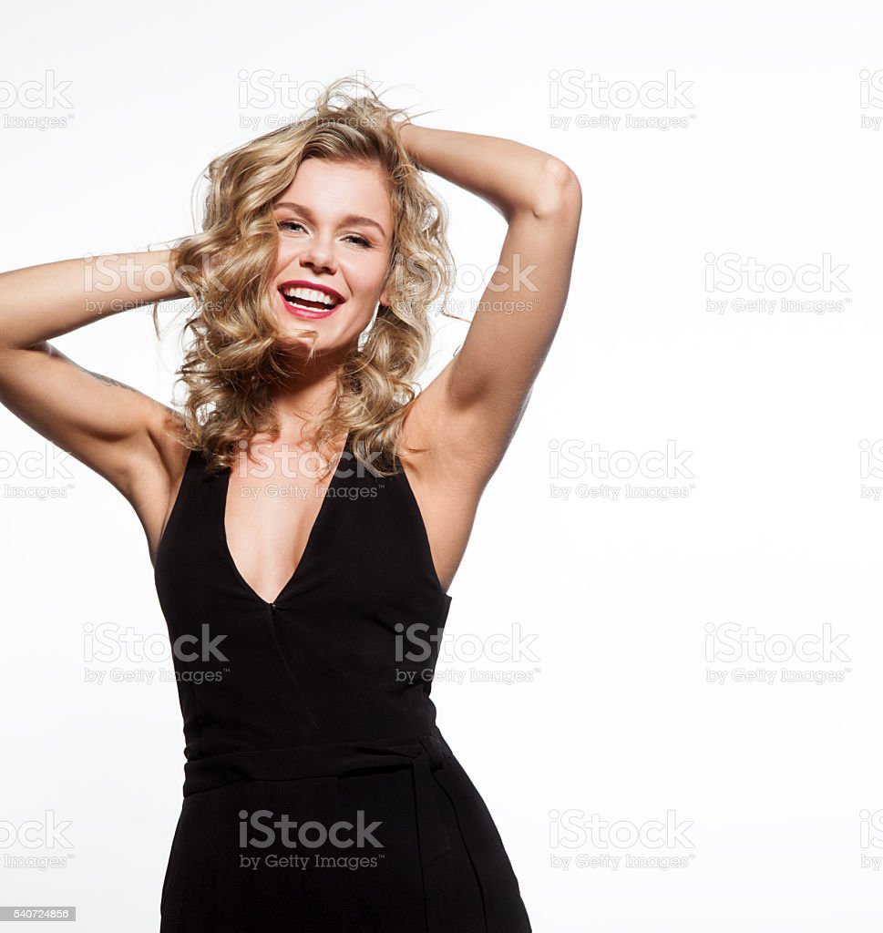 Smiling beautiful woman with a thick, shiny hair stock photo