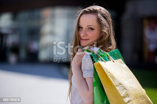 615594632 istock photo Smiling beautiful woman with shopping bags 485795626