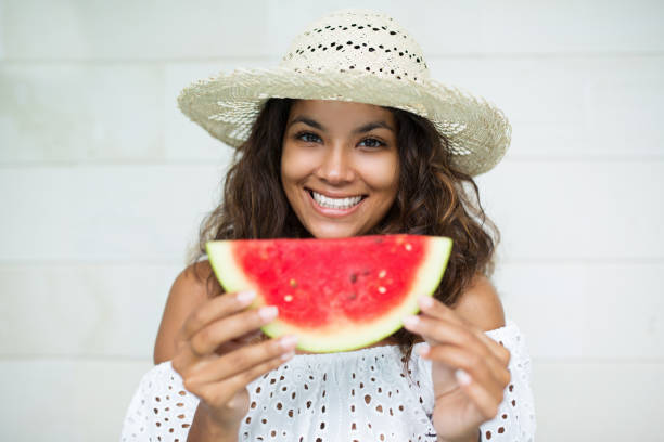 Smiling Beautiful Woman With Slice of Watermelon stock photo
