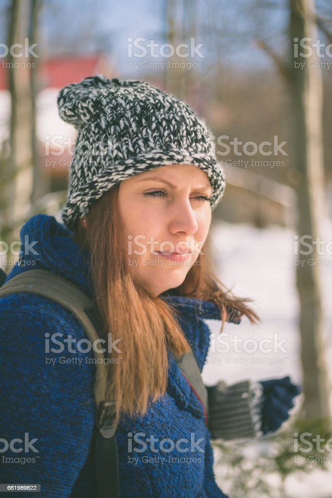 Smiling beautiful young woman relaxing outdoor in a winter day royalty-free stock photo