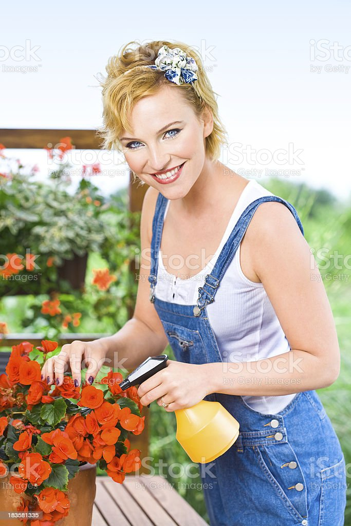 Smiling beautiful young woman with flowers royalty-free stock photo