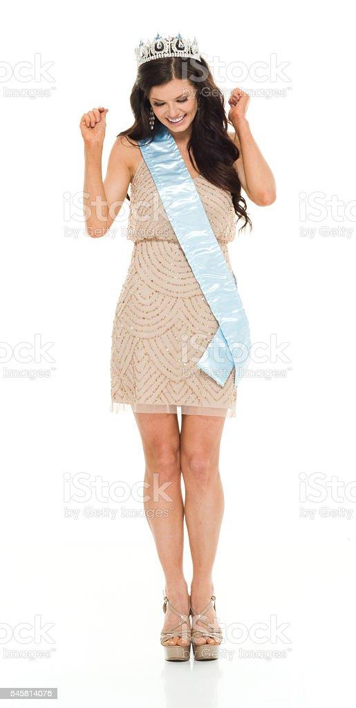 Smiling beauty queen cheering stock photo