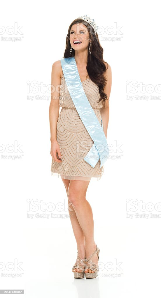 Smiling beauty queen looking up stock photo