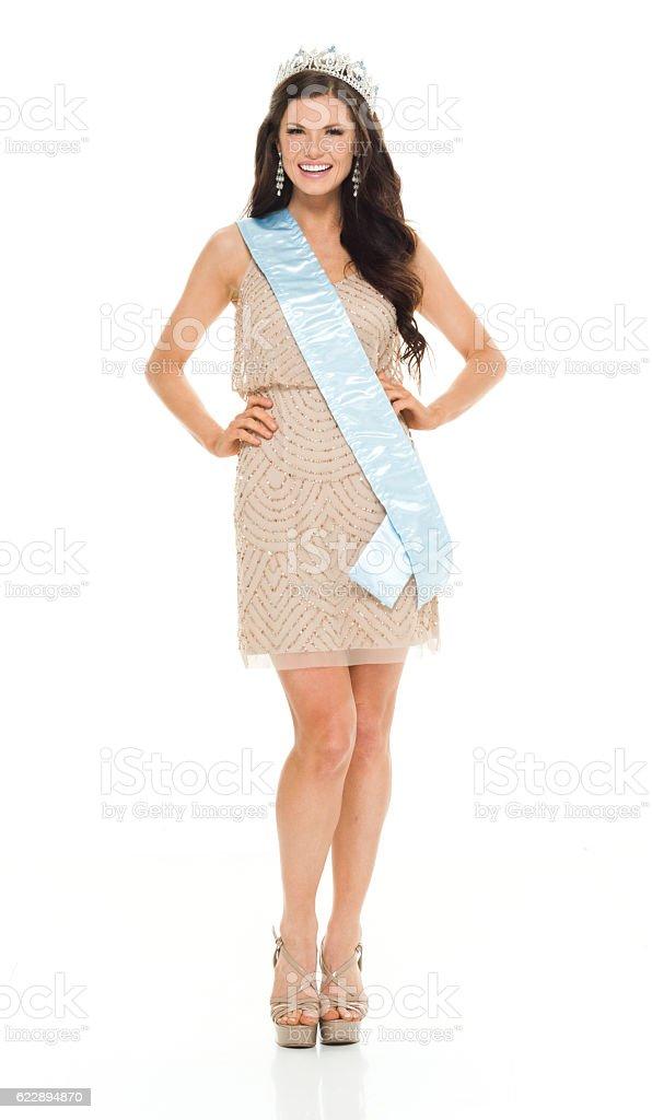 Smiling beauty queen standing stock photo