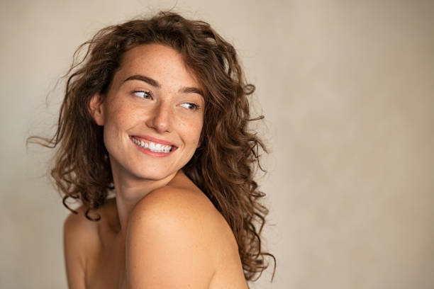 Smiling beauty woman with freckles looking away stock photo
