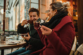 istock Smiling best friends having fun in the outdoors bar in Germany 1002087620