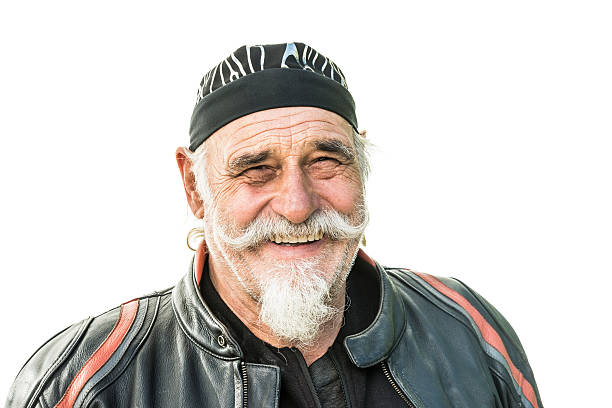 smiling biker isolated on white - biker stock photos and pictures