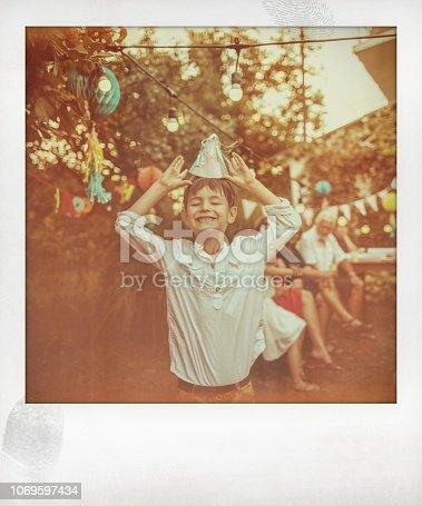 Polaroid photo of smiling birthday boy