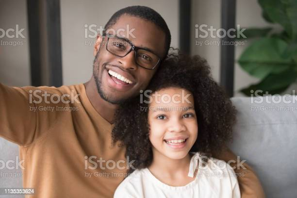 Smiling black father and child taking selfie looking at camera picture id1135353624?b=1&k=6&m=1135353624&s=612x612&h=nmscyvhjphkgsn5dwaylhrhprsvfyaaiz2pln8ub5ps=