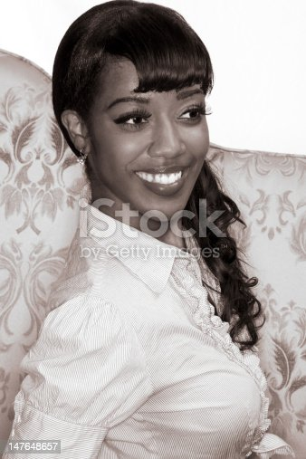 Portrait of happy Afro-American young woman in 50s-60s retro style - monochrome image is sepia toned