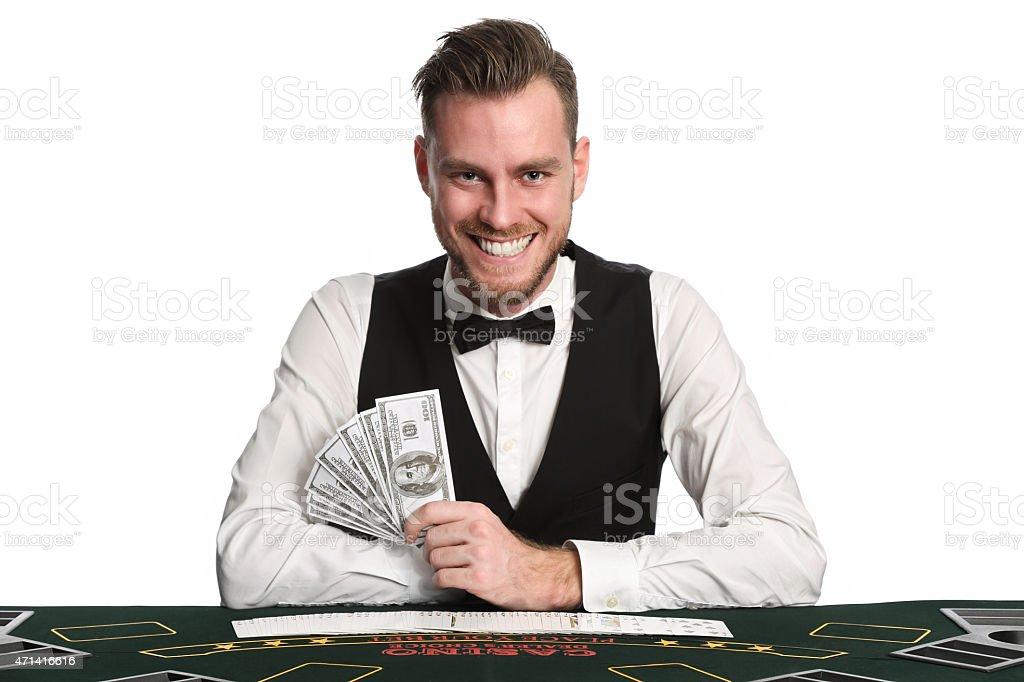 Smiling black jack dealer stock photo