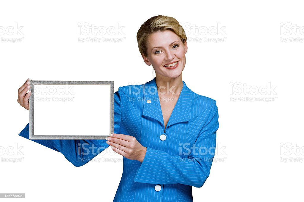 Smiling blond business woman showing blank sign in frame royalty-free stock photo