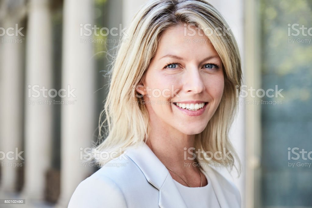 Smiling blond businesswoman stock photo