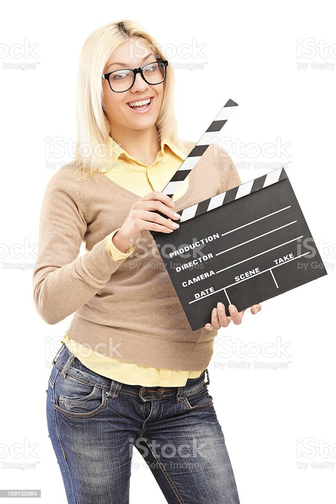 Smiling blond female holding a movie clap royalty-free stock photo