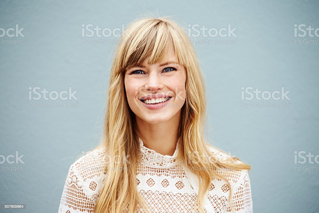 Smiling blond lady stock photo