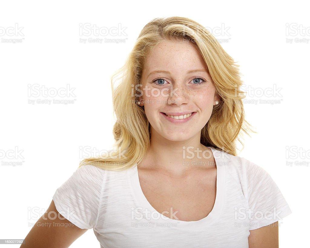 Smiling blond teenage girl stock photo