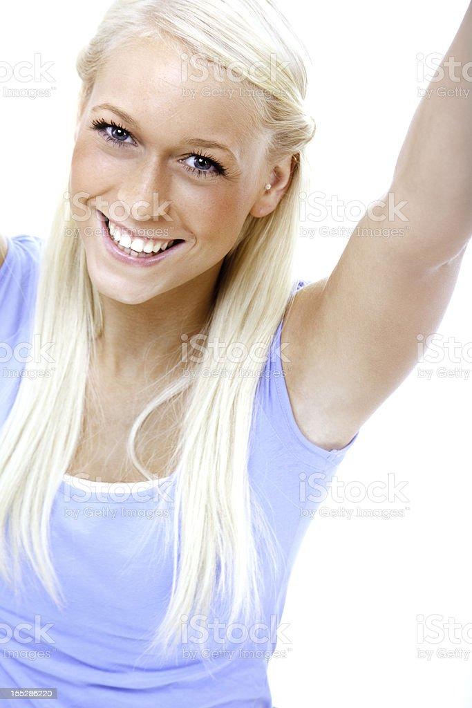 Adolescente blonde souriante sur blanc - Photo