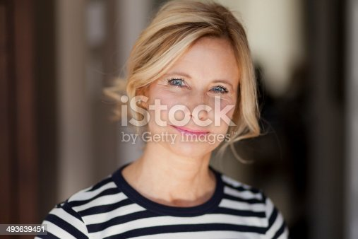 istock Smiling blond woman wearing a striped shirt 493639451