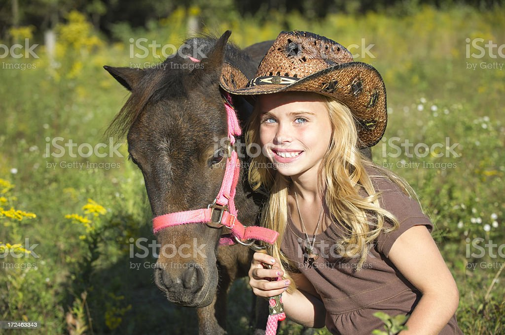 Smiling Blonde Cowgirl and Her Horse in Portrait stock photo