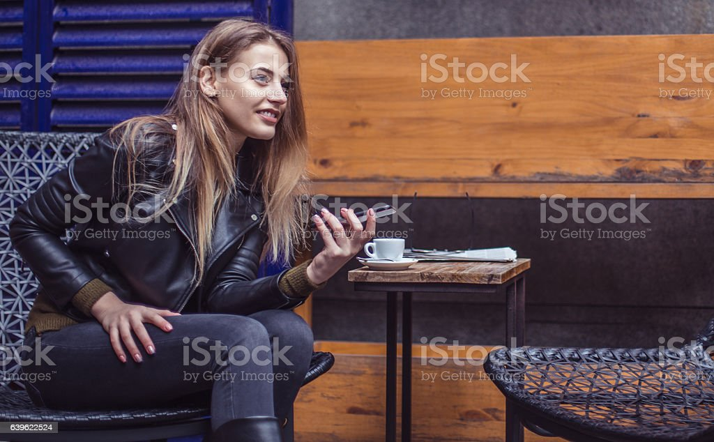 Smiling blonde girl at the cafe stock photo