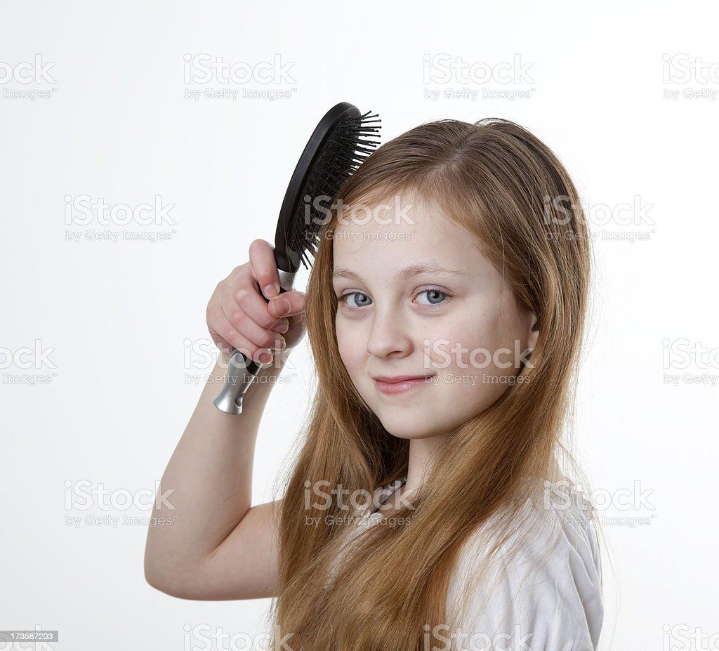 Smiling Blonde Girl Brushing Hair royalty-free stock photo