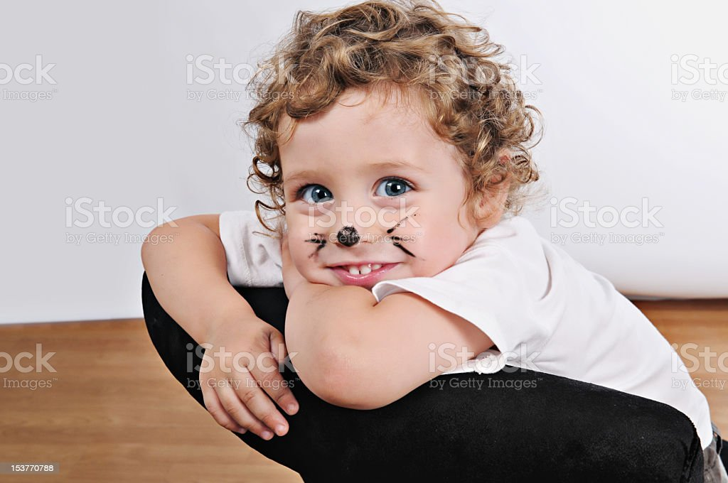 smiling blonde kid painted as kitty royalty-free stock photo
