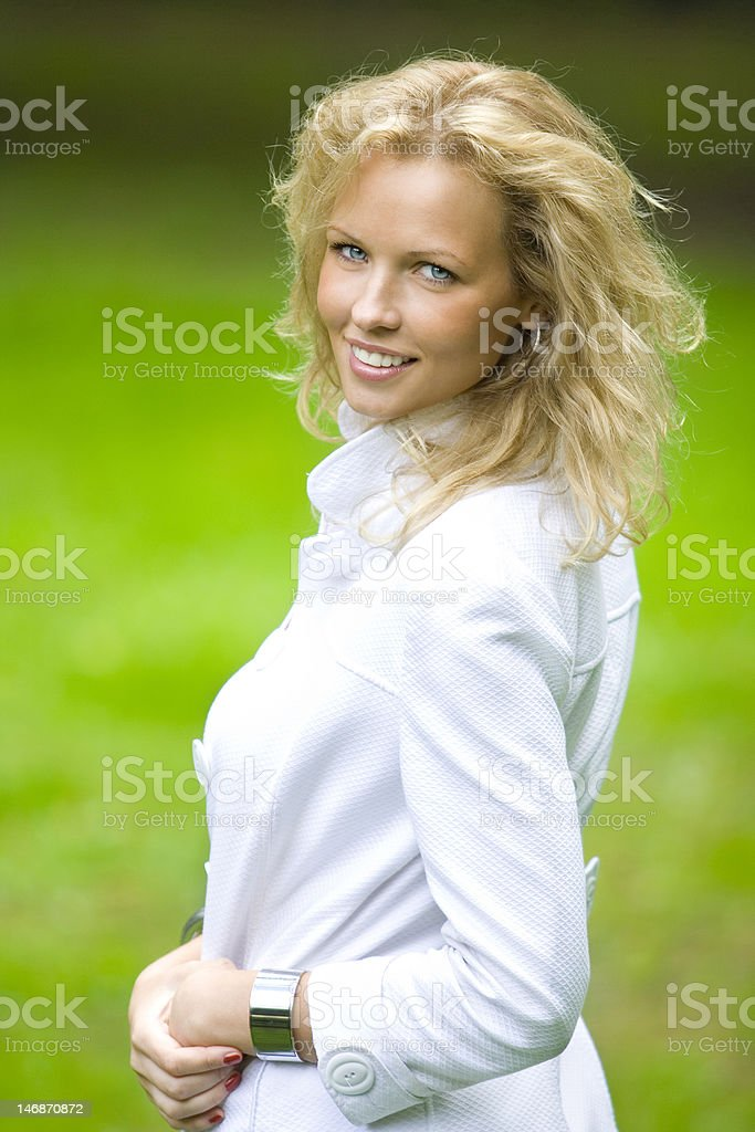 smiling blonde woman in park royalty-free stock photo