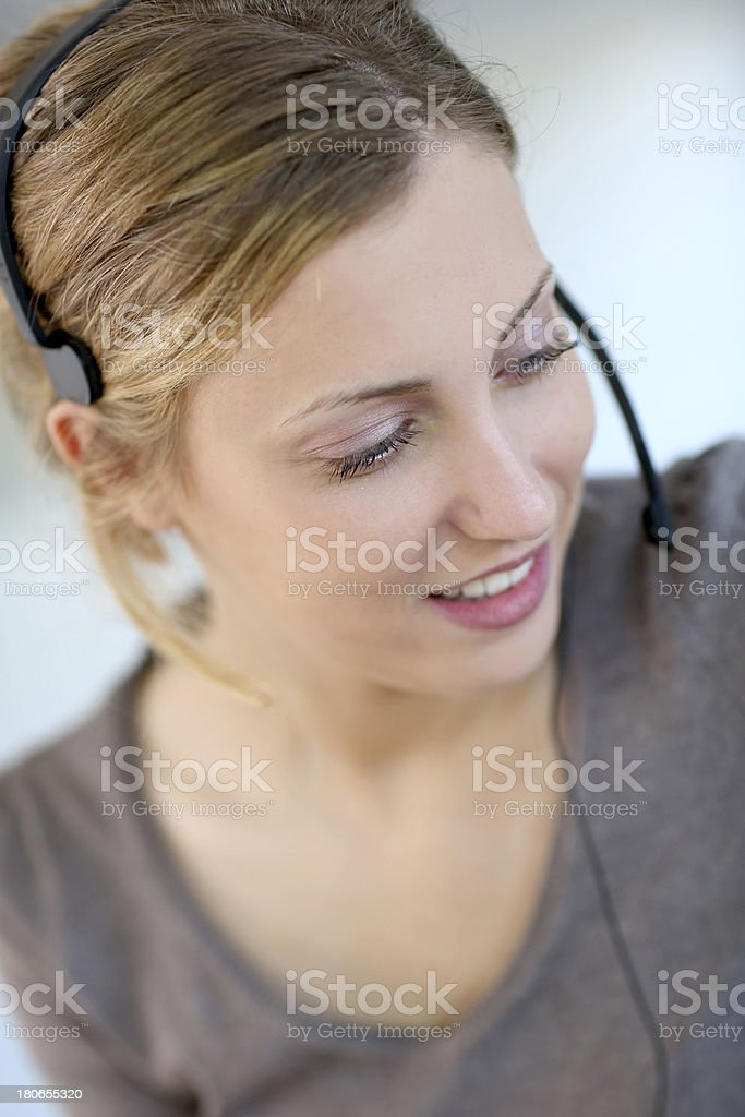 Smiling blonde worker with a headset stock photo