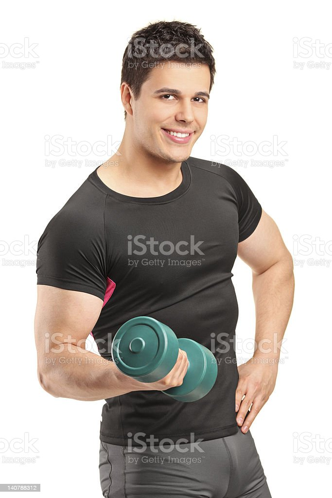 Smiling bodybuilder lifting up a dumbbell royalty-free stock photo