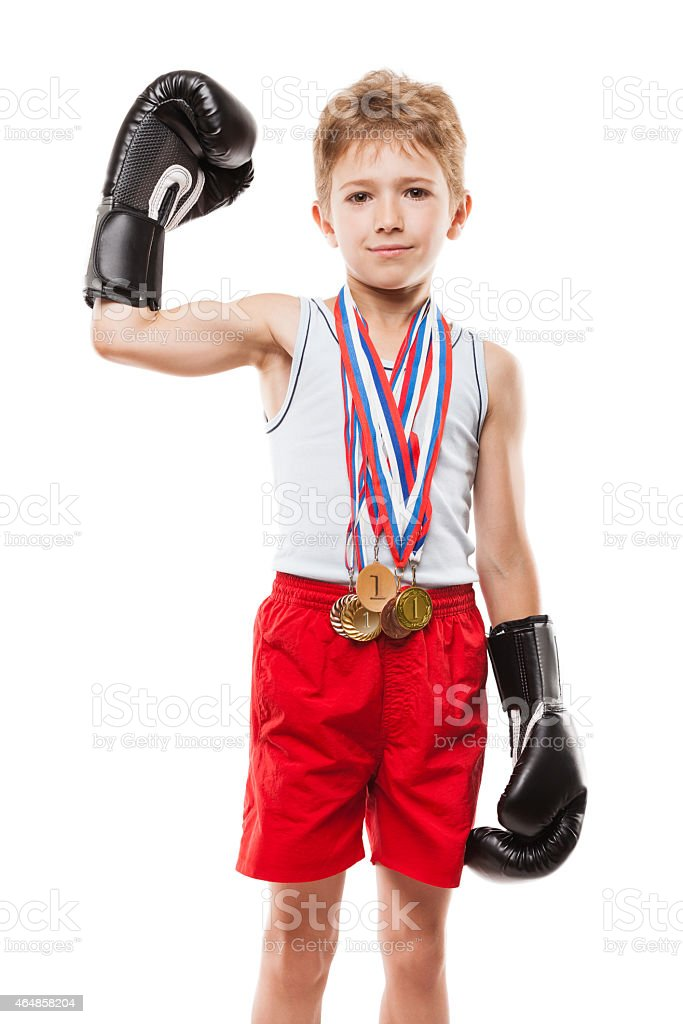 Smiling boxing champion child boy gesturing for victory triumph stock photo
