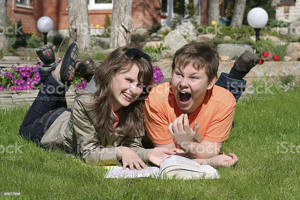smiling boy and girl with a book royalty-free stock photo