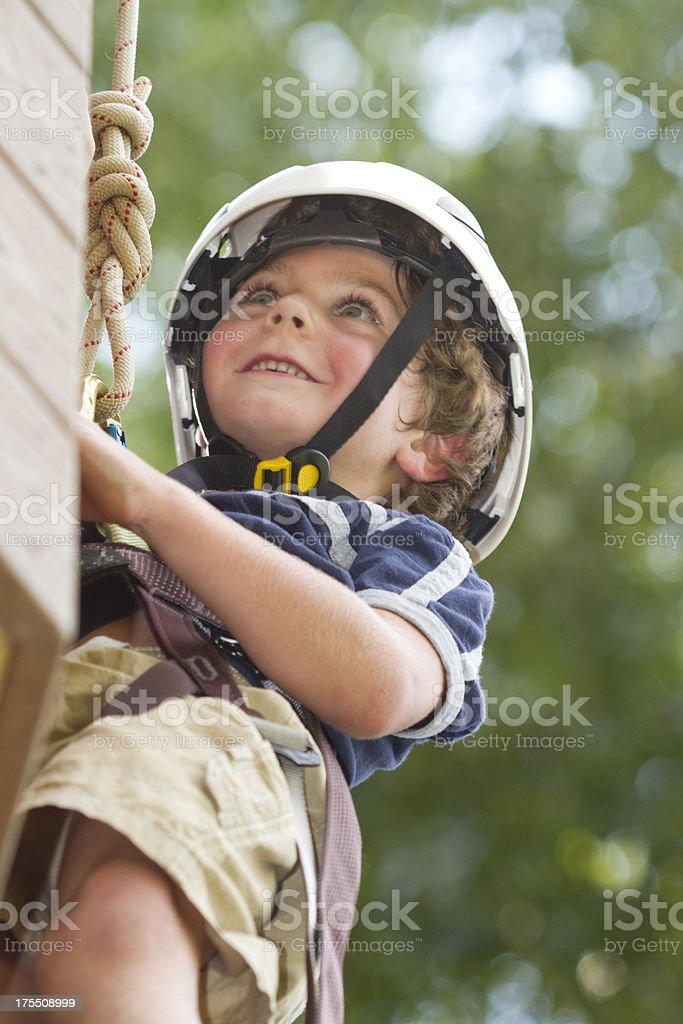 Smiling Boy Climbing  Tower / Rock Wall. royalty-free stock photo