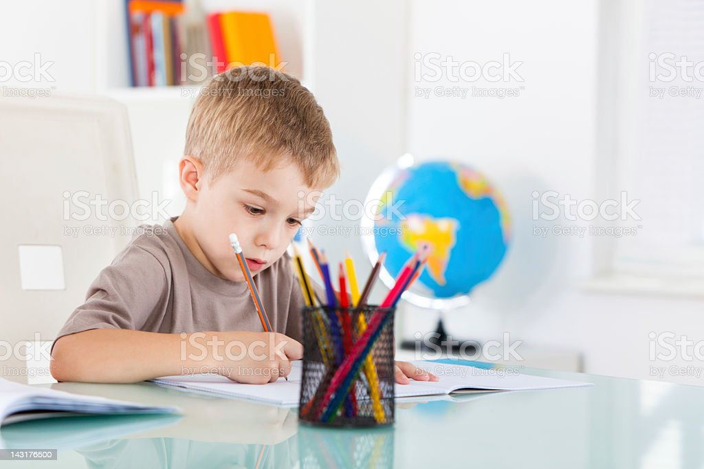 Smiling boy drawing royalty-free stock photo