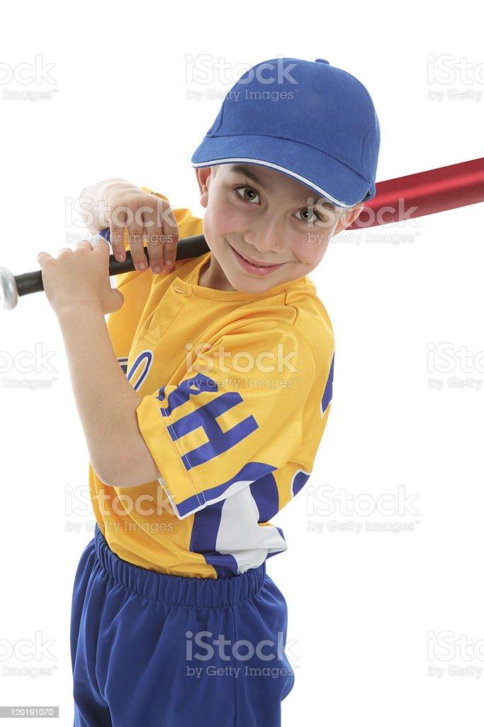 Smiling boy holding a baseball tball bat stock photo