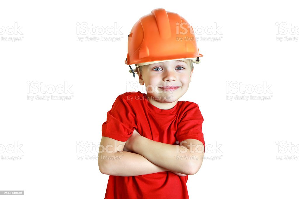 Smiling boy in the construction helmet royaltyfri bildbanksbilder