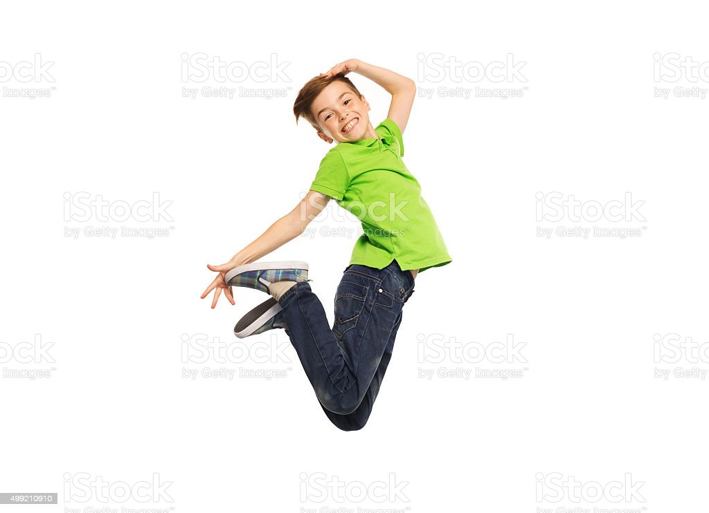 smiling boy jumping in air stock photo