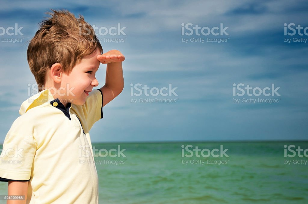 smiling boy looking away from his palm stock photo